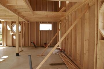 construction d'une maison en bois Fotobehang