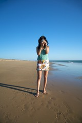 taking a picture at the beach