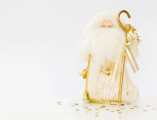 Christmas Santa with golden bell over white - copy space