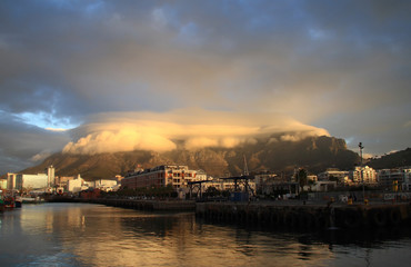 "Table Mountain is covered with the cloud ""table-cloth""."