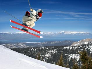 A young man jumping high at Lake Tahoe resort