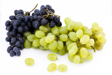 two bunches of red and white grapes on white background
