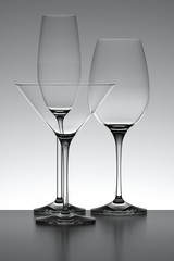 Three glasses isolated over a gray backlit background.