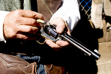 Upclose horizontial photo loading bullets into a handgun