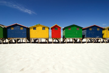 Multi colored beach huts in a row