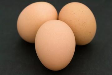 Three eggs on a black background