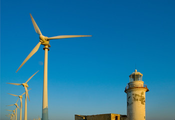 Wind turbines and old lighthouse