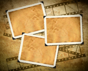 Retro photo framework against an old paper with filmstrip