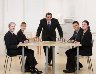 Co-workers sitting at conference table having meeting