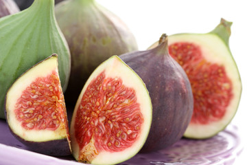 close-ups of fresh figs isolated on white - food and drink