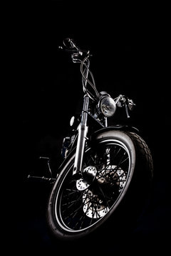 Chopper motorcycle front isolated on black