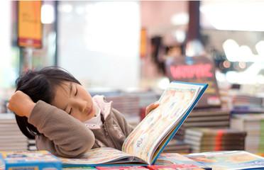 Young Girl enjoy Reading at book shop