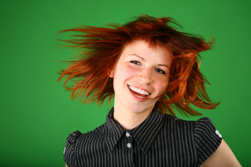 Portrait of girl with red flying hair