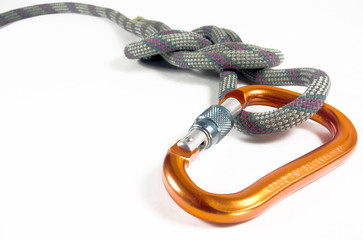 A locking carabiner and a knot isolated against  white