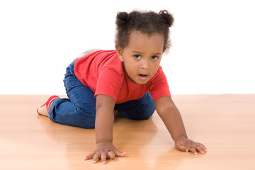 Adorable and beautiful african baby a over wooden floor