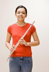 Confident musician holding flute