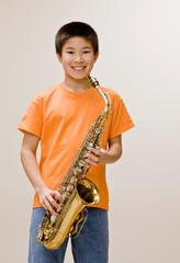 Confident musician holding saxophone