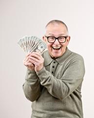Wealthy man excitedly holding group of twenty dollar bills