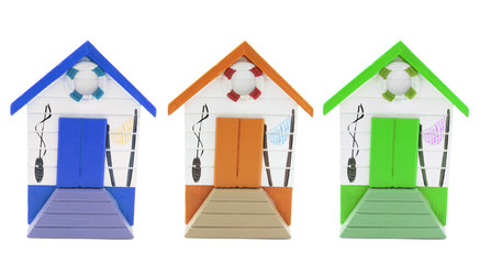 Miniature Beach Houses on Isolated White Background