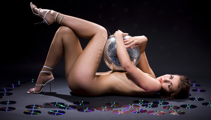 picture of lovely girl with disco ball and optical discs