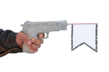 hand with fire a shot newspaper pistol and flag. fake