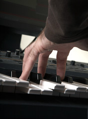 Play on the piano. White and black
