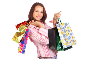 Shopping smile woman. Isolated over white background.