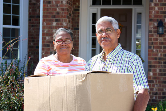 Senior Minority Couple With A Moving Box