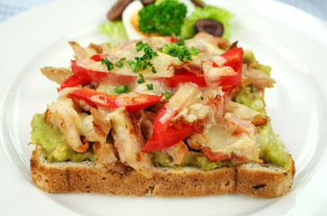Grilled open chicken sandwich with avocado and cheese