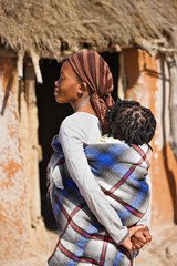 African mother carry child in a traditional way