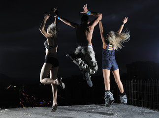 threen teens jumping in air representing disco and party