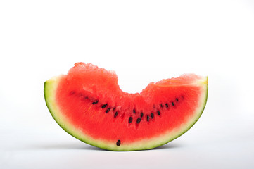 A slice of watermelon on white background, close up