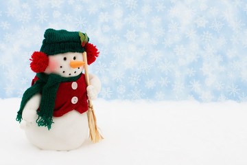 Snowman on snow with snowflake background