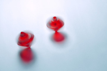 Capture of two rolling dice with motion blur