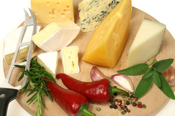 Cheese and herbs on a wooden board. Food photography.