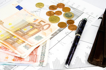 Business financial concept with diagrams pen and euro money