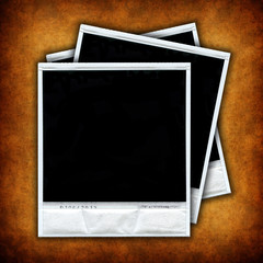 three empty photo frames over grunge background - square format