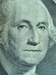 Macro shot of George Washington on one dollar bill.