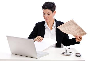 Businesswoman reading financial newspaper,