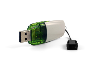 White and green flash drive isolated