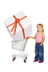 Little girl with shopping cart and large present - isolated