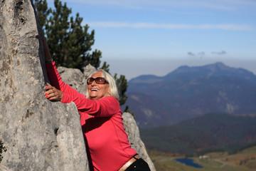 Senior Lady is climbing