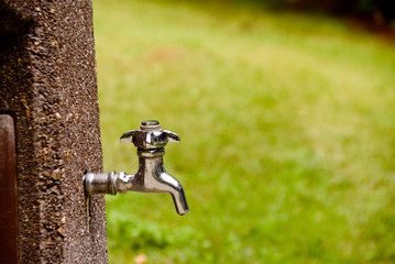A outdoor spigot ready to spit out water.