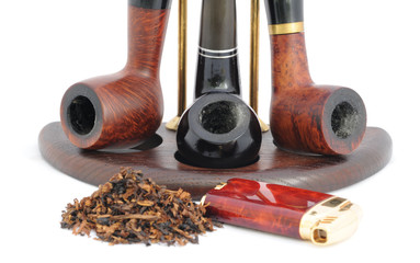 Tobacco,  Lighter and Three Smoking Pipes on the Stand.