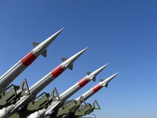 Four missiles against clear blue sky