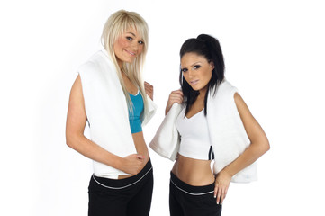 Young women with towels around their necks after a workout