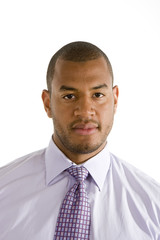 A serious looking black man in a dress shirt and tie