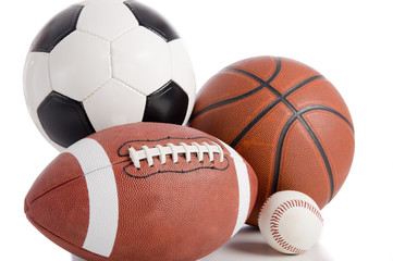 A group of sports balls on a white background