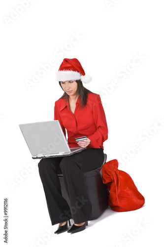 Santa \'s secretary is shopping online for Christmas gifts.\