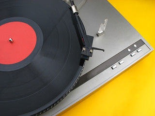 player for vinylic disks on  yellow background